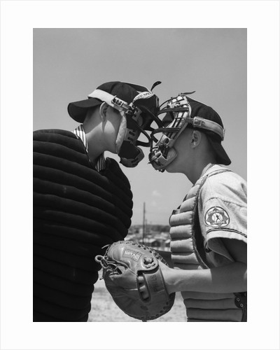 1950s boys in baseball uniforms face to face arguing umpire & catcher by Corbis