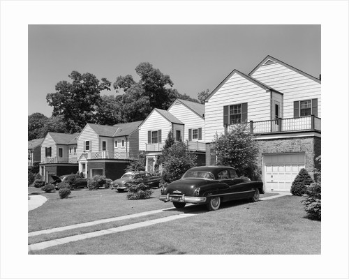 1950s suburban street of typical homes queens new york by Corbis