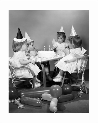 1960s girl quadruplets having second birthday party by Corbis
