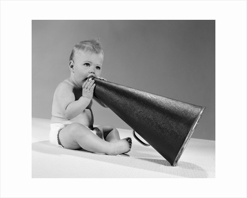 1960s baby in diaper seated holding megaphone by Corbis