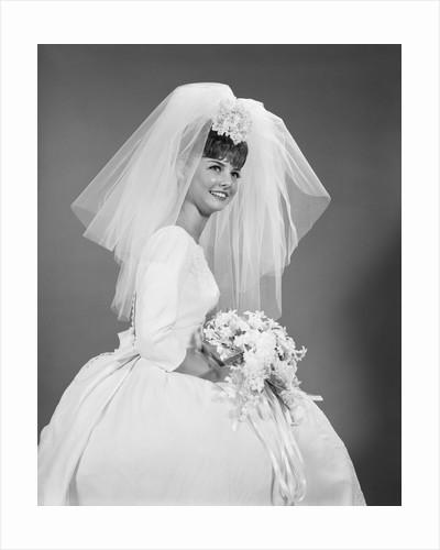 1960s bride portrait in wedding dress veil bridal bouquet by Corbis