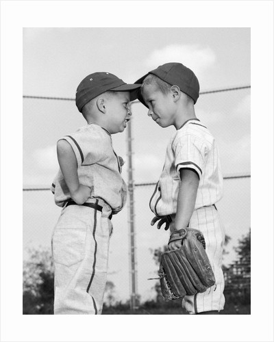 1960s two boys playing baseball arguing by Corbis