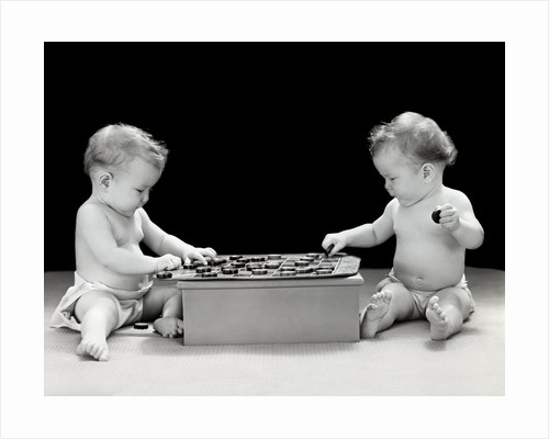 1930s 1940s twin babies playing game of checkers together studio by Corbis
