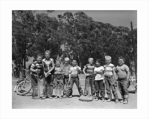 1950s line-up of 9 boys in tee shirts with bats & mitts facing camera by Corbis