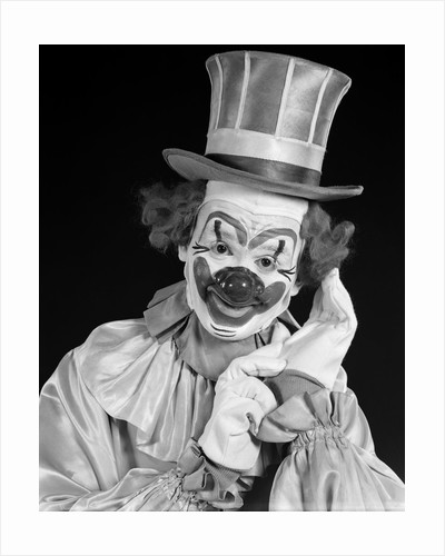 1950s portrait of clown wearing top hat smiling looking at camera by Corbis