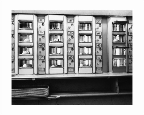 1920s 1930s 1940s 1950s series automat cafeteria vending machine windows containing cake and pie desserts by Corbis