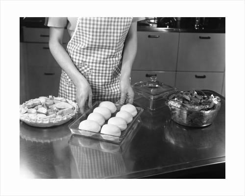 1940s 1950s woman preparing dinner baking rolls and pie by Corbis