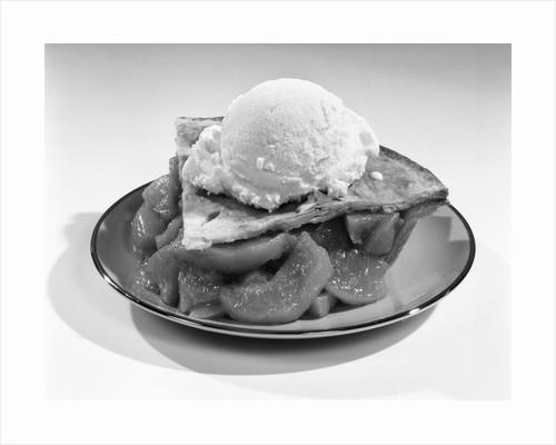 1960s still life of slice of peach pie with vanilla ice cream on top by Corbis