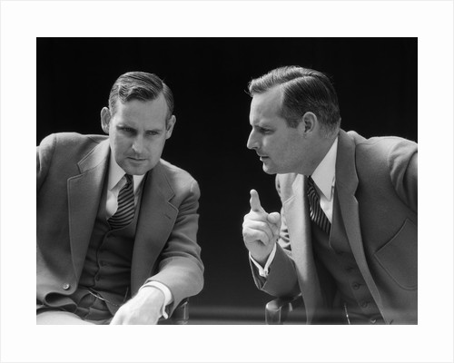 1930s 1940s businessman talking seriously to himself or his twin alter ego by Corbis