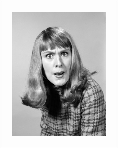 1960s head shot angry woman looking at camera by Corbis