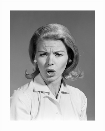 1960s woman blond hair in flip looking at camera mouth open angry mad facial expression by Corbis