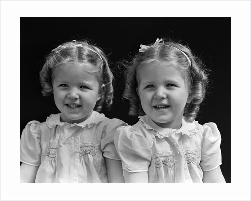 1930s portrait twin girls smiling by Corbis