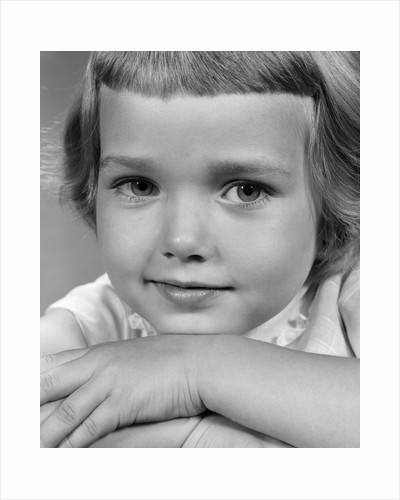 1960s young girl posing with arms near face by Corbis