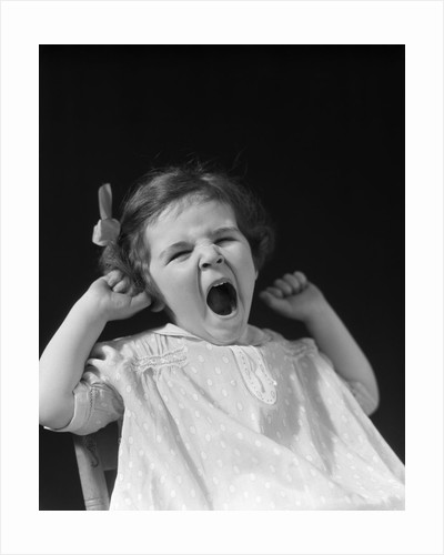 1930s little girl yawning by Corbis