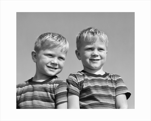 1950s portrait two twin blond boys smiling wearing striped tee shirts brothers by Corbis