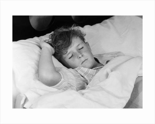 1940s 1950s boy sleeping in bed by Corbis