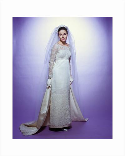 1960s young woman bride portrait bridal veil empire waist gown lace bodice hem full length by Corbis