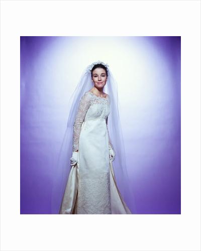 1960s young woman bride portrait bridal veil empire waist gown lace bodice by Corbis