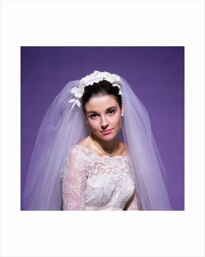 1960s young woman bride portrait bridal veil head shoulders smiling pearls by Corbis