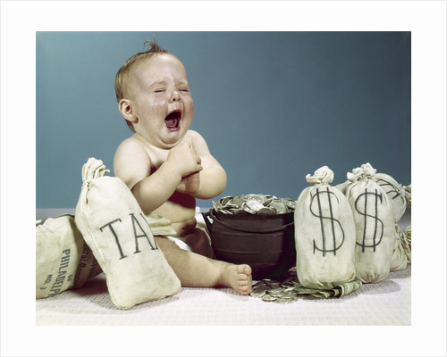 1960s baby crying laughing mouth wide open with pot of coins and bags of money including bag labeled tax by Corbis