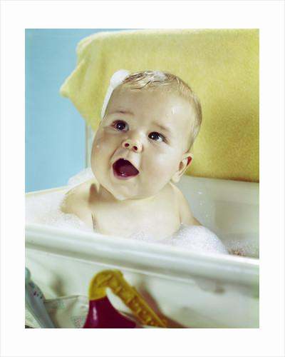 1960s happy baby taking bath by Corbis