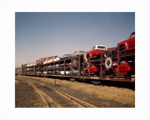 1960 1960s new cars & trucks transported on northern pacific railroad railway train transportation by Corbis