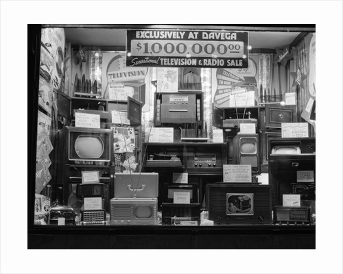 1940s window of store selling radios and televisions advertising a million dollar sale by Corbis