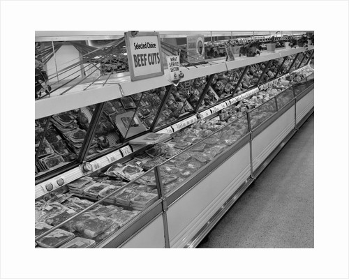 1950s grocery store meat section by Corbis