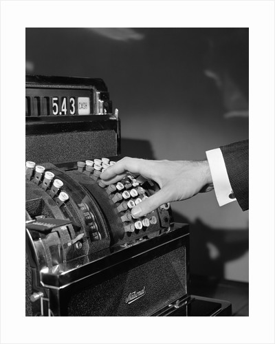 1930s 1940s man's hand pushing price buttons on cash register by Corbis