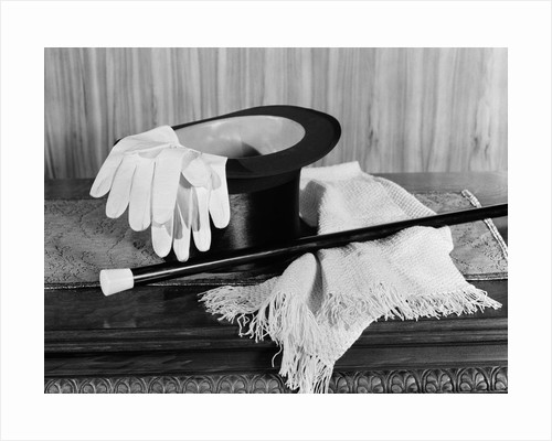 1920s 1930s man's formal evening wear top hat white gloves scarf and cane for night on the town by Corbis