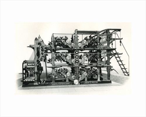 Vintage newspaper printing and folding machine by Corbis