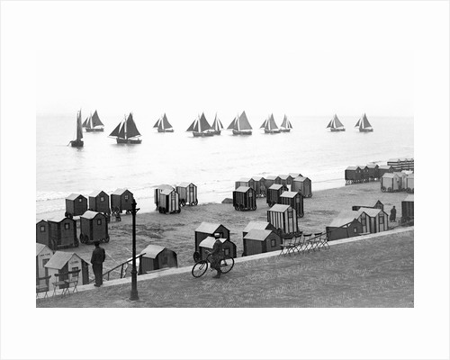 Beach scene in Victorian England, ca. 1900. by Corbis