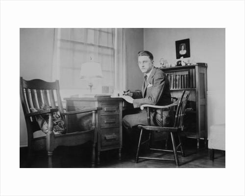 Harvard grad student studies as his desk, ca. 1938 by Corbis