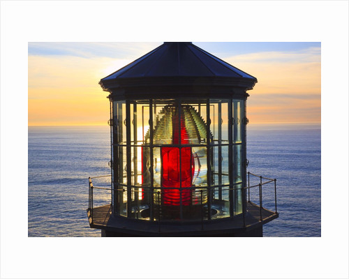 Cape Meares Lighthouse lens at sunset, from Cape Meares, Oregon, USA by Corbis