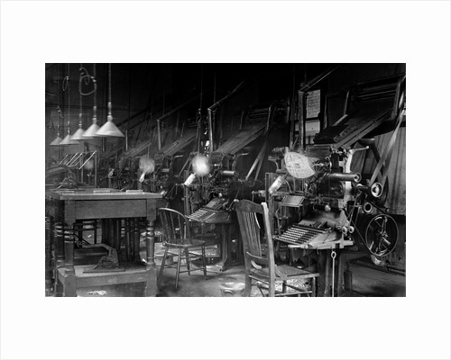 Typesetting operation in an industrial environment, ca. 1900 by Corbis