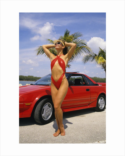 1980s Woman In Red Swimsuit In Front Of Red Sports Car by Corbis
