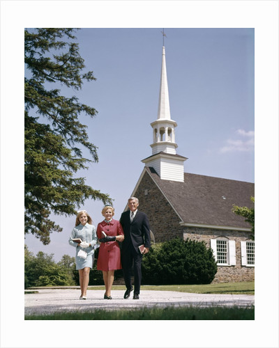 1960s Smiling Family Leaving Church Each Carrying Bible by Corbis