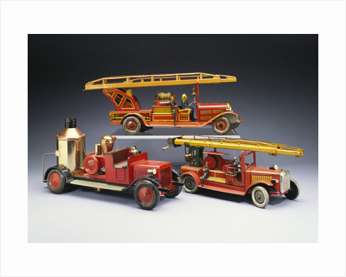A Tipp and Company tinplate keywind overhead ladder fire engine with a Bing heavy tinplate fire pumper and a Gunthermann tinplate windup fire ladder truck by Corbis