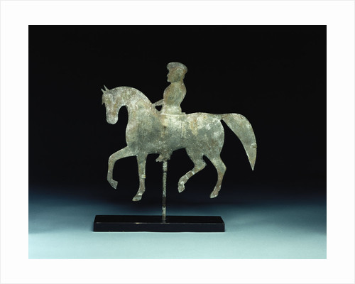 A silhouette horse-and -rider weathervane by Corbis