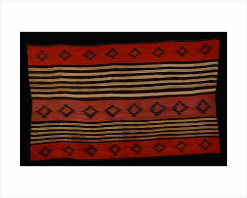 A transitional Navajo woman's blanket by Corbis