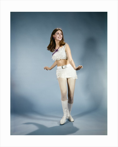 1970s Smiling Young Woman Dancing Wearing White Fringed Top Miniskirt And Go-go Boots by Corbis