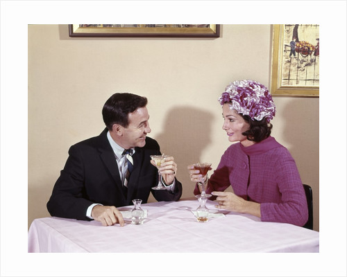 1960s Couple Drinking Cocktails At Table Husband Wife Indoor by Corbis