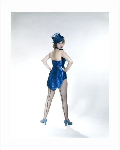 1960s Woman Looking Over Shoulder Wear Dance Costume Blue Sequined Top Hat Silk Tails Fishnet Seamed Stockings Looking At Camera by Corbis