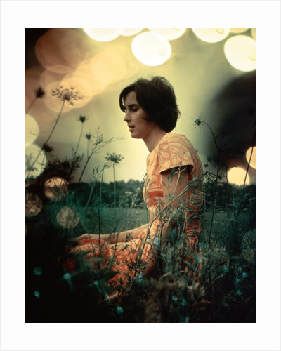 1970s Serious Woman In Field Flowers With Soft Focus Special Effect by Corbis