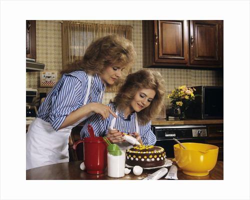 1970s Mother Daughter Dressed Alike Decorating Cake by Corbis