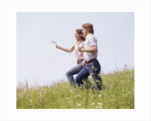 1970s Couple Running Holding Hands Field by Corbis