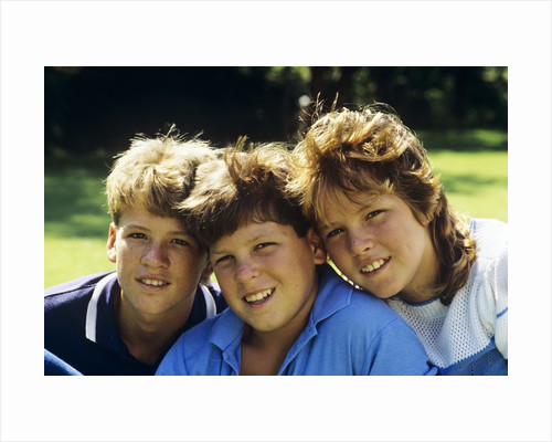 1980s Two Brothers And Their Sister Posed Heads Together Smiling Looking At Camera by Corbis