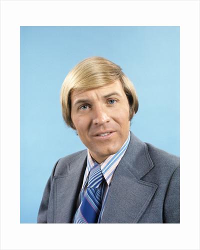 1970 1970s Retro Portrait Of Blonde Man Wearing Grey Suit Blue Striped Tie by Corbis