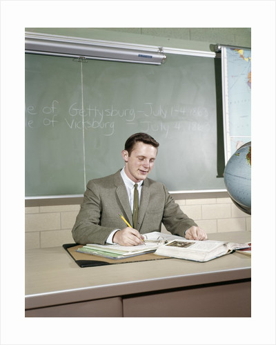 1960s Student Studying Desk Globe Open Book Writing Chalkboard High School by Corbis