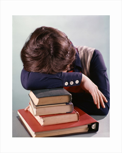 1960s 1970s Female Student Head Down On Pile Of Books Asleep Exhausted by Corbis